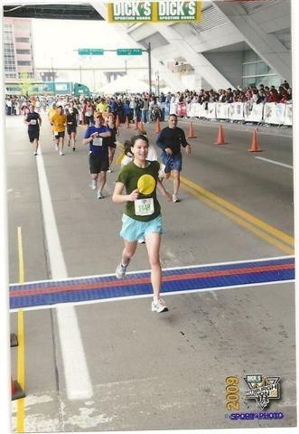 Angela crosses the finish line! Photo courtesy of Angela Ferris.